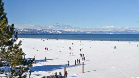south lake tahoe: South Lake Tahoe, California, USA, 10 January 2016. Unidentified crowd enjoy the frozen waters of Lake Tahoe in the winter. Lake Tahoe is a winter tourist destination mostly due to winter sports Editorial