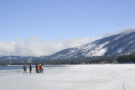 south lake tahoe: South Lake Tahoe, California, USA, 10 January 2016. Unidentified group of people enjoy enjoying the frozen waters of Lake Tahoe in the winter. Lake Tahoe is a tourist destination mostly due to winter sports