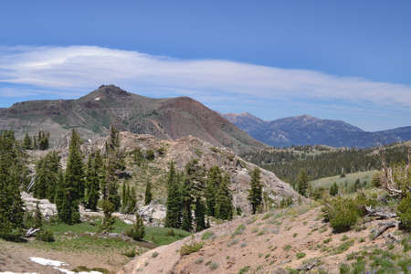 sierras: View from the trail to Winnemucca Lake from High Top Lake in the summer,  featuring mostly melted snow packs and a cloud stripe over the mountains
