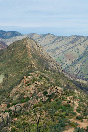 chaparral: Picture of a winding path up a steep trail to a peak- adventure and achievement concept. This photo features the Blue Ridge trail at the Stebbins Cold Canyon in California one year after the Wragg Fire. Stock Photo