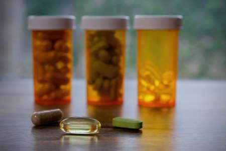 dietary: Dietary supplements in bottles on a windowsill