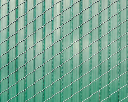 oriented: Green pattern of vertically oriented stripes of plastic woven with obliquely oriented wire -texture or background