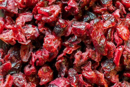 Red, dry cranberries with sugar- food texture or background
