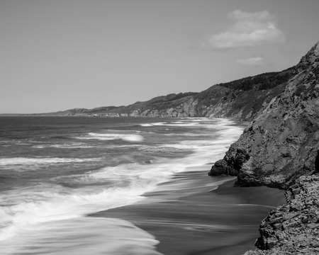 Black and white rendering a view of the Pacific Coast from Point Reyes National Seashore, Marin County, California, USA, near Alamere Falls, during the high tide