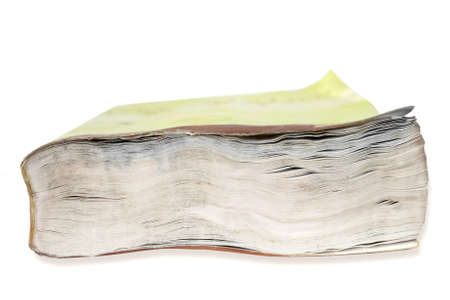 Clousep on the fore edge of a book damaged by water against white background Stock Photo