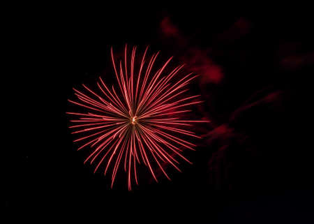 Bursting fireworks against black background celebrating an important event like new years eve or US independence day Stock Photo