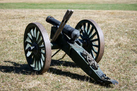 American Civil War Cannon on the grass at a Civil War Re-enactment in Duncans Mills, California, USA, viewed from the back