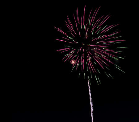 Bursting fireworks against black background celebrating an important event like new years eve or US independence day 写真素材