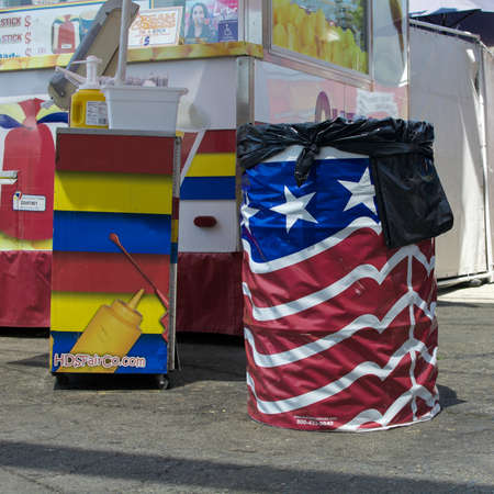 Sacramento, California, U.S.A. 23 July 2017. Trash Can wrapped in the American Flag. The fair is annual and features California industry and culture.