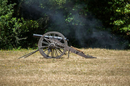 American Civil War Cannon on the grass at a Civil War Re-enactment in Duncans Mills, California, USA, viewed from the side
