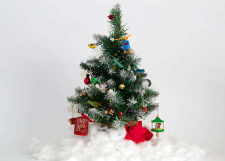 christmas tree featuring plastic animals wooden birds fake snow and other ornament toys against