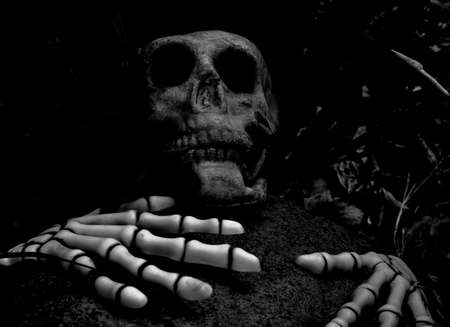 Halloween skeleton in black and white a rock fell over the person Stock Photo