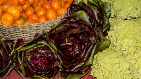 Romanesco broccoli, Red Butter Lettuce and cutties arranged for sale in a farmers market Banco de Imagens