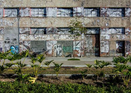 RIO DE JANEIRO, RJ , BRAZIL - May 22, 2018: Abandoned building with graffiti near VLT Carioca line 1, Pier Maua, Sajtókép