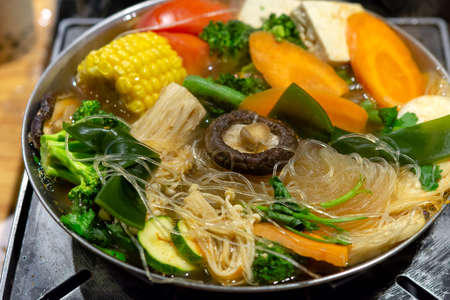 Tawanese vegetarian boiling pot ready to eat, dinner angle, closeup