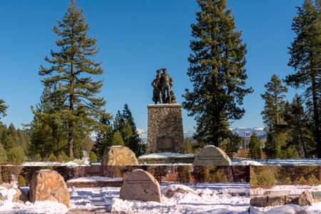 Truckee, CA , USA - January 14, 2019: Monument at Donner Memorial State Park Visitors center on a winters day with accumulated snow and blue sky Editorial