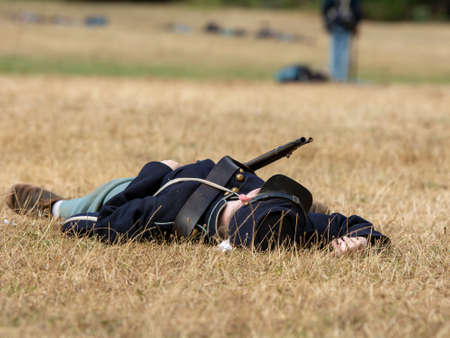 Duncan Mills, CA - July 14, 2018: Reenactor playing dead union solder at a Civil war reenactment