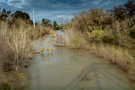 Putah Creek in Winters, California, USA, on a winters day after heavy storms viewed from the bridge