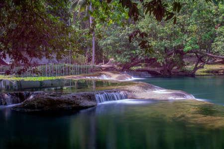 Beautiful waterfall in Thailand, near the Namtok Chet Sao Noi Park, Saraburi, featuring lush green tropical vegetation, long exposure