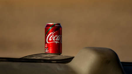 Gardnerville, NV, USA- January 10, 2019. Coca-cola can on the dashboard of a car in the desert, selective focus