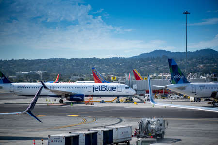 San Francisco, CA- September 4, 2019: Jet Blue airplane ready for boarding, viewed from the glass window of an airport in the Unitd States. JetBlue Airways Corporation is a major American airline low cost passenger carrier, and the sixth largest in the Un