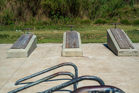 Old-fashioned exercise boards for sit-ups at Itaipava Municipal Park in Petropolis, Rio de Janeiro, Brazil Banco de Imagens