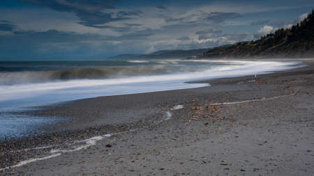 Long exposure Agate Beach at Patrick's point state park, in Northern California, USA, l featuring predominantly blue colors and some clouds
