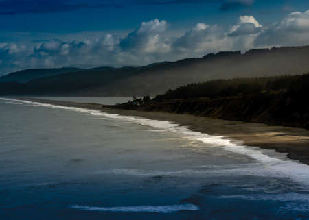 Long exposure Agate Beach in Patrick's point state park, from above, in Northern California, USA, l featuring predominantly blue colors and some clouds Stok Fotoğraf