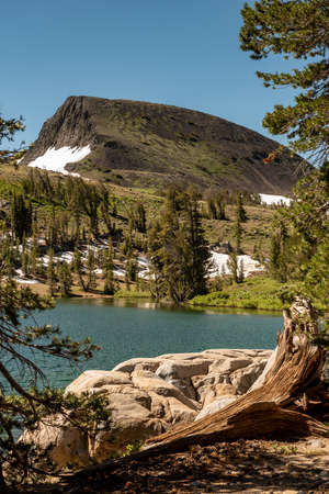 Sierra Nevadas Frog Lake at mid-day in the spring, featuring rocks,  mountain and a few pine trees, on a cloudless blue sky day Stok Fotoğraf