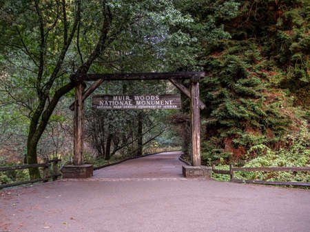 The entrance sign and paved trail of Muir Woods National Monument, California, USA