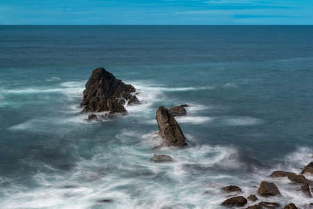 Long exposure of three rocks, Headlands State Park, Medocino County, Northern California; USA, blue is the predominant color