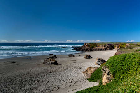 Mendocino, California, USA, Fort Bragg, long exposure of the ocean by the Glass Beach on a cloudles blue sky evening