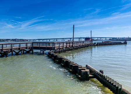 Waterfront Park of Martinez, California, USA, featuring the docks, bridge, pier and boardwalk on a sunny day with blue clear sky