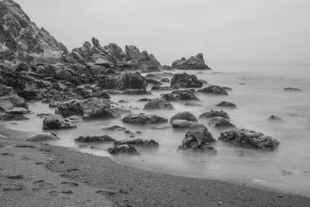 Long exposure of the Pacific Coast from Goat Rock state park, Sonoma Coast, California, USA, in black and white