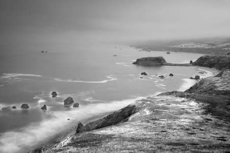 Panoramic view of the Pacific Coast from Goat Rock state park, Sonoma Coast, California, USA, on a gloomy, hazy day in black and white