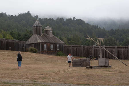 Fort Ross,CA, USA, July 25, 2020. The public visits the Russian Fort on a gloomy, foggy day, during the COVID-19 pandemics. All museums and indoor spaces were closed but the main gate was open.