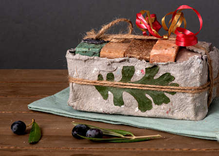 organic olive soap packaged in recycled paper, on wooden background. Located in Guinda, California Stockfoto