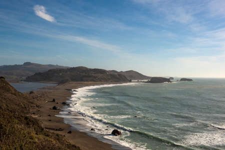 Landscape view of Sonoma Coast in California, USA, seen from near the town of Jenner, overlooking the Russian River and beyond, on a cloudless, blue sky day