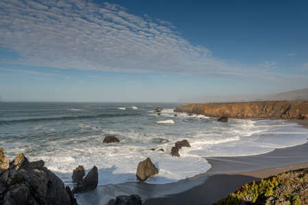 Landscape view of Sonoma Coast in California, USA, seen from near the Schoolhouse Beach parking lot, on a cloudless, blue sky day