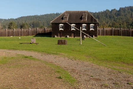 near Salt Point, 19 January 2021. Old Building and canon at Fort Ross state park, a Russian Fort, on a sunny day, California, USA