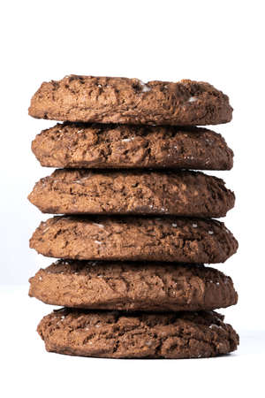 Six chocolate cookies stacked and isolated on white