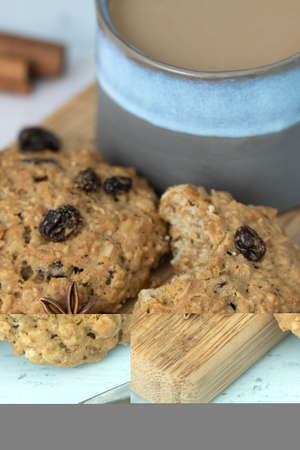 Close-up on oatmeal and raisins whole wheat cookies, spices and coffee with half and half on bamboo serving tray against blue background – comfort food side view