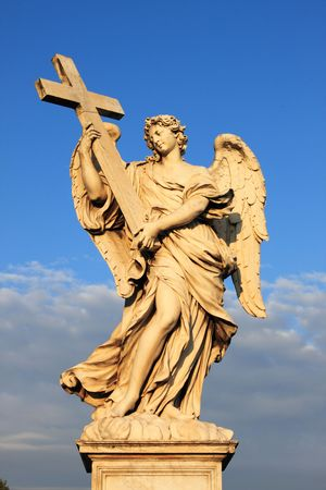 Angel statue in Saint Angel bridge, Rome (Italy). Symbol of peace, purity, holy and divinity photo