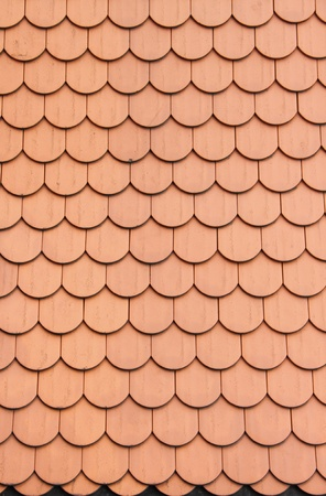 Perspective of red roof clay tiles photo