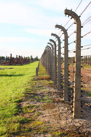 Barbed wire electrical fence at Auschwitz Birkenau, Poland photo