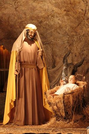 VATICAN - DECEMBER 25: Saint Joseph and Jesus Christ scene of the christmas crib on December 25, 2011 in Vatican City