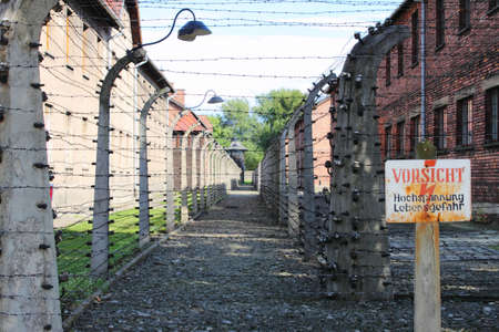 extermination: Barbed wire electrical fence at Auschwitz concentration camp, Poland