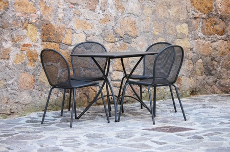 Iron table and chairs on outdoors cafe in Mediterranean Europe photo