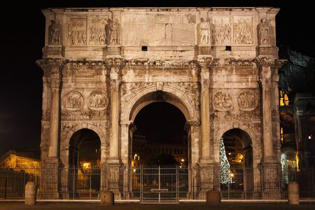 Arch of Constantine by night in Rome, Italy