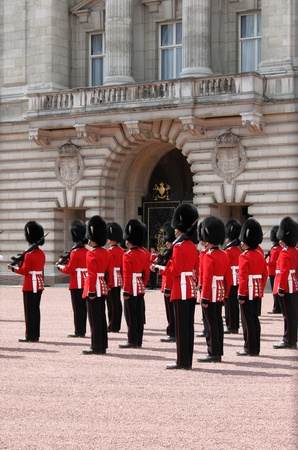 LONDON - MAY 5: British Royal guards performs the Changing of the Guard in Buckingham Palace on May 5, 2010 in London, UK